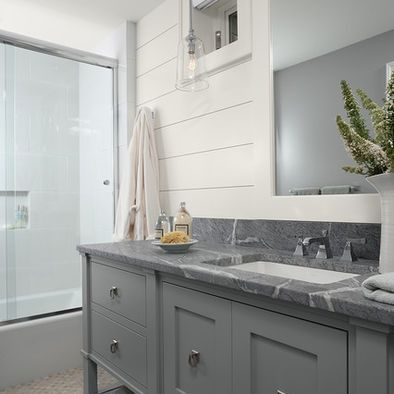 Soapstone is a top choice for bathroom vanities. Unlike marble, travertine, or granite, it is not negatively affected by water. (Just make sure you get the high quality, architectural grade.) Because soapstone is nonporous, it resists stains. It also retains and radiates heat. The Countertop Investigator by Anthony Greer is one of the best resources for comparing the cost and practicality of different countertop materials.