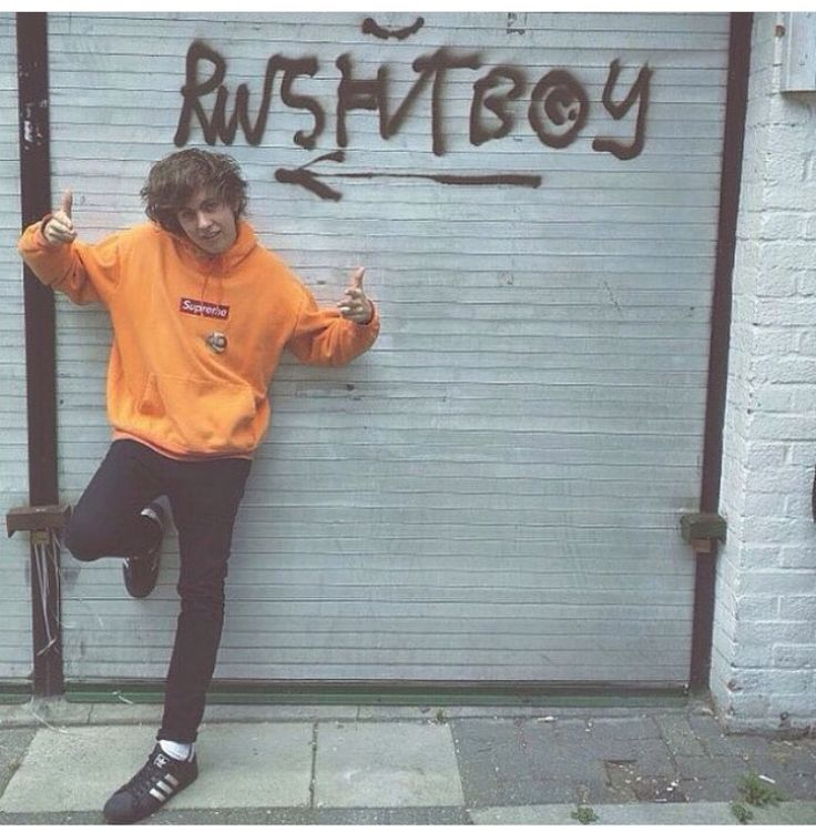 RATBOY in front of a old garage