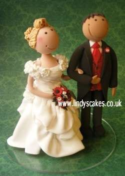 Bride and groom topper by Lindy Smith