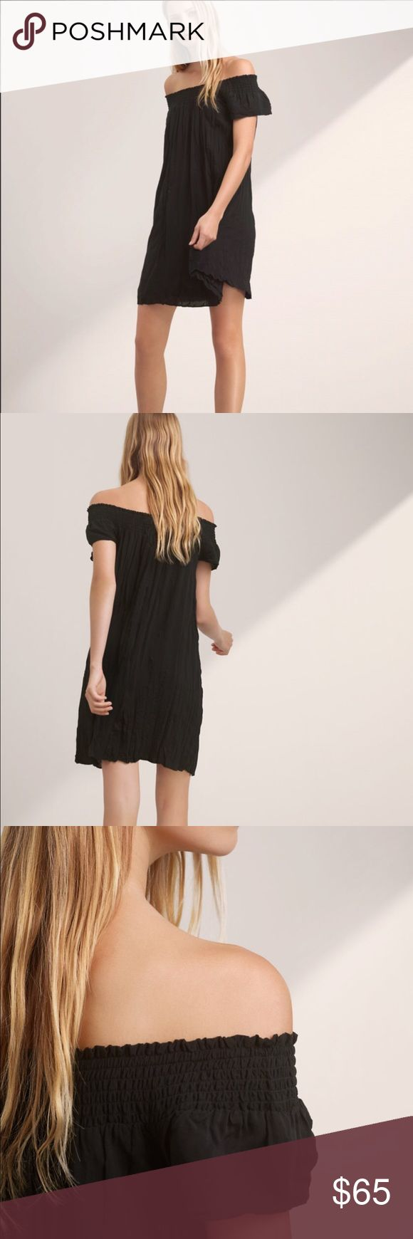 """NWOT Aritzia Talula Horacio Dress - Black SOLD OUT - Made with lightweight, drapey twill, this piece has smocking to keep the off-the-shoulder neckline in place. The trapeze silhouette is feminine and seasonal.   100% Viscose Imported Dry Clean  Size // Fit Fits true to size. Take your normal size. Model is 5'9.5""""/177cm wearing a size XS Aritzia Dresses Mini"""