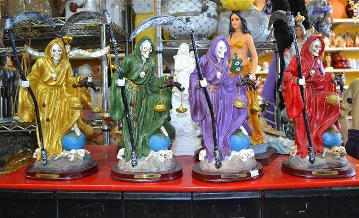 Image: Statues of Santa Muerte for sale at EL Viejo Lazaro Botanica