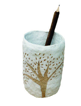 Pencil holder. Paper pulp carved.