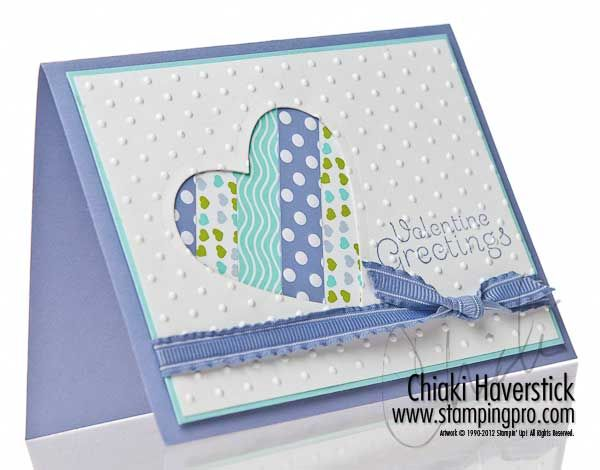 lovely handmade card in blues ... negative space die cut heart backed with strips of lovely patterned paper ... great for scraps too beautiful to toss ...