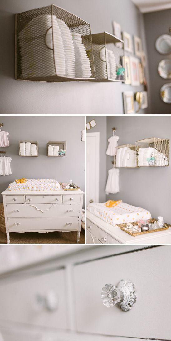 Love the metal file boxes on the wall for diapers. Easy to spray paint!   Sweet, Feminine Nursery in Peach, Gold, and Gray