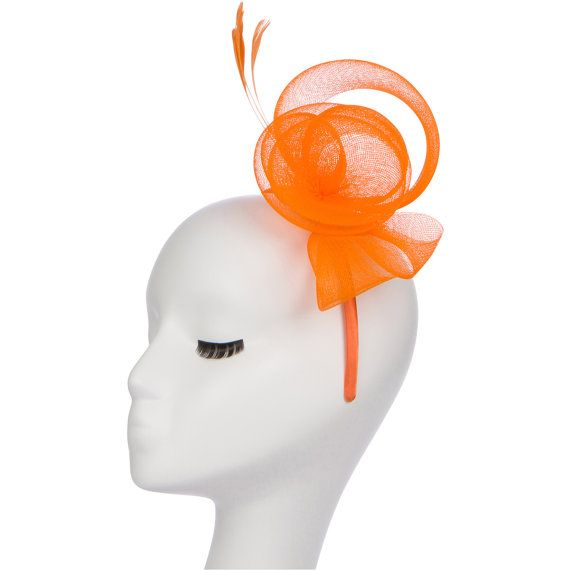 Orange fascinator hat with mesh and feather detail by Masinaco