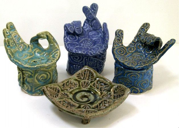 Unique pottery soap dishes by Earth Maiden. Hand built, hand signed by artist and it keeps your soap dry!