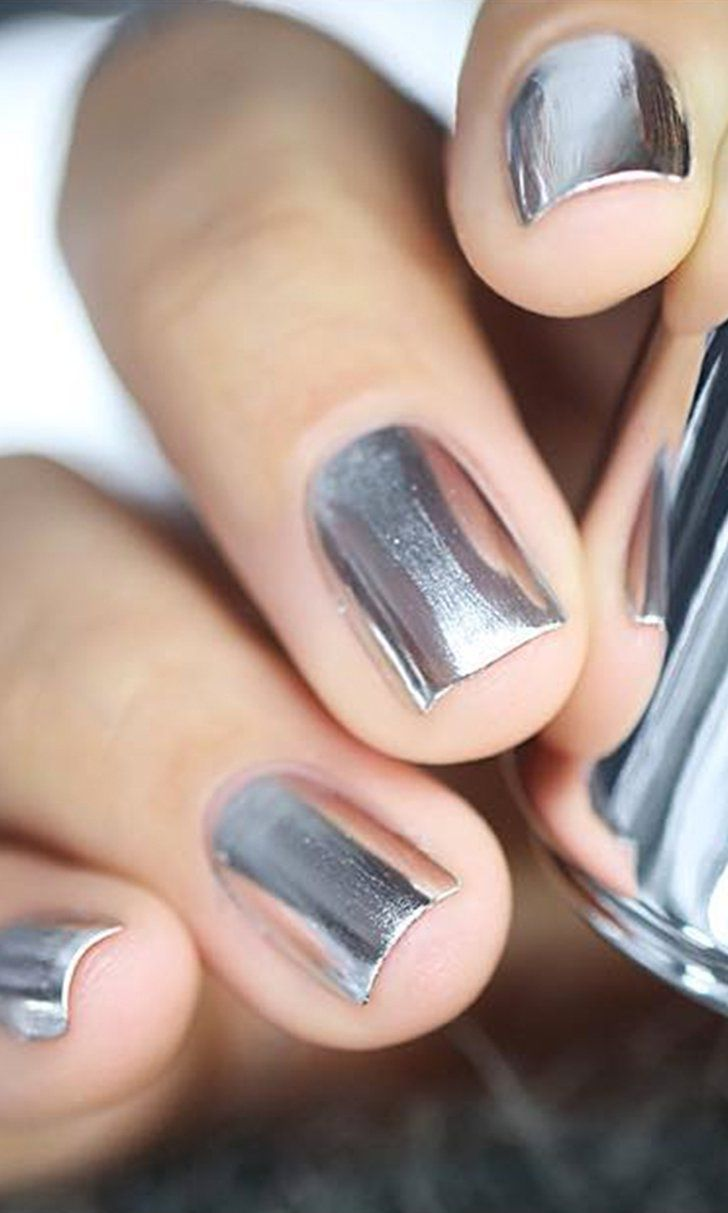 This mirrored nail polish is magical! It creates a reflective chrome effect on the nails.