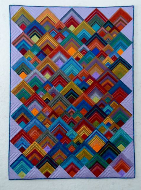 New Fangled - and modern, I still love quilts whenever, or wherever, to me it is all about the Country - and can turn a city home decor to a gentler time Color Quilt (477x640)