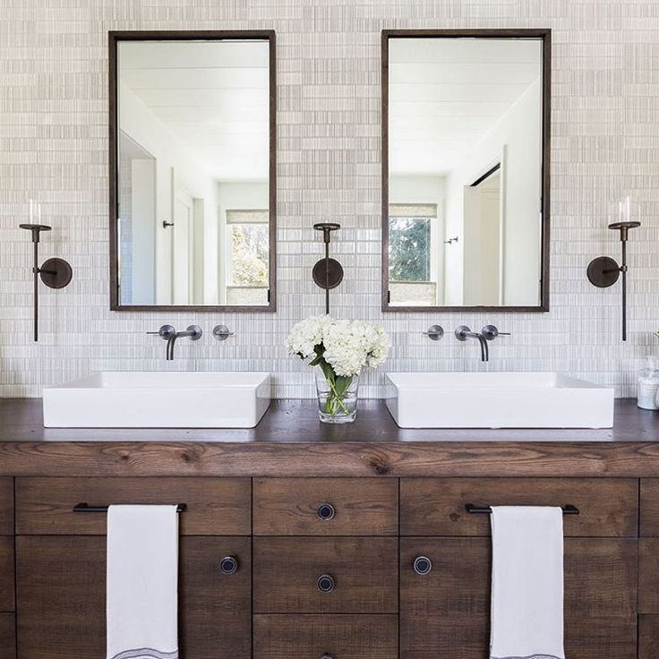 Vessel sinks + wood vanity