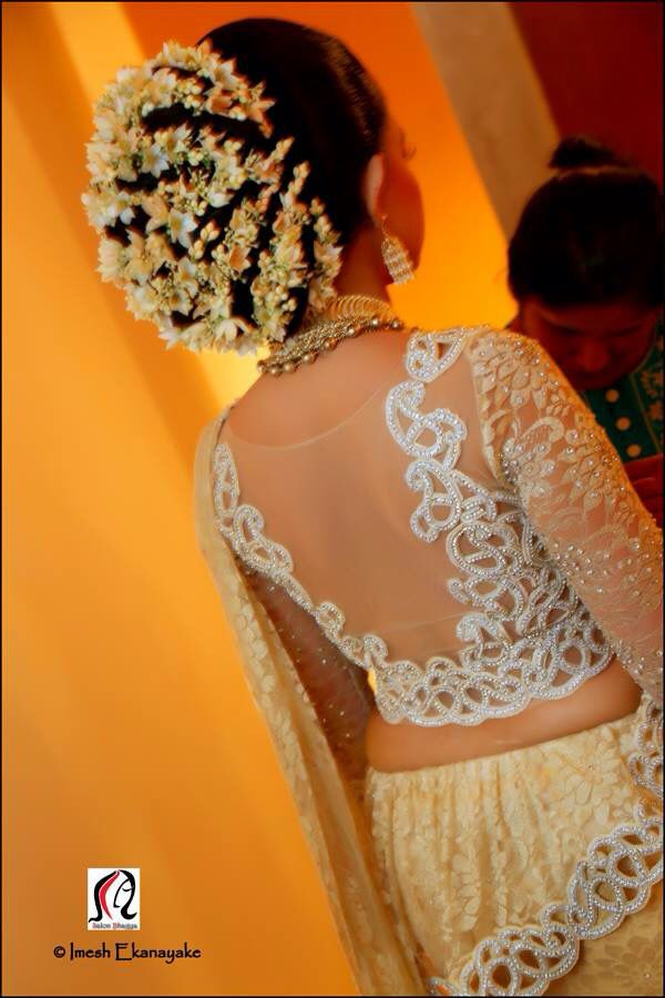 What a beautiful large low bun with embellishments! Care however should be taken before adopting such hairstyles, as due to it's high static charge, it will cause phlegm to move up in the throat, causing the voice to quaver & a frequent urge to clear the throat. A heavy chabi chhalla with a long & wide hook if inserted at the edge of the pleats of the saree, will reduce this problem as it's hook will activate the acupressure points that act to keep the throat clear.