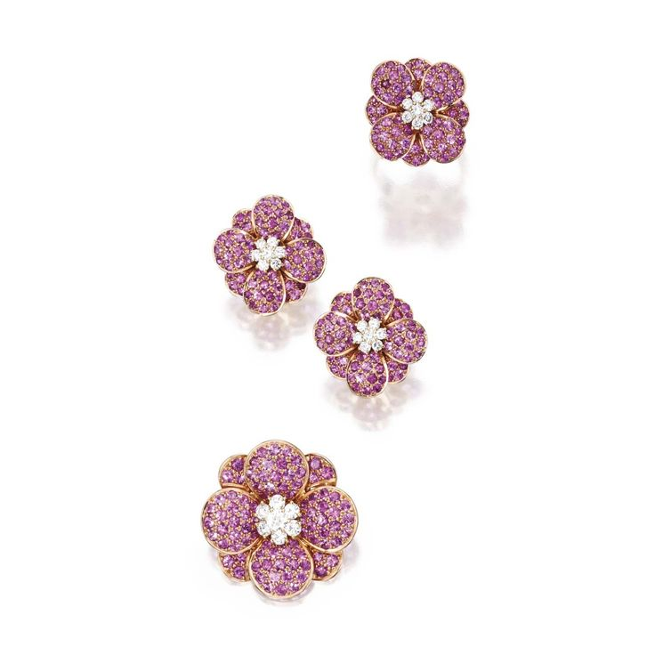 SUITE OF 18 KARAT GOLD, PINK SAPPHIRE AND DIAMOND JEWELRY, VAN CLEEF & ARPELS. Comprising a brooch, ring and earrings of floral design set with pink sapphires centered by round diamond clusters weighing a total of approximately 1.80 carats, the brooch signed VCA, numbered B1500 D9, the earrings signed VCA, numbered B3560 D10, with a workshop mark, the ring size 6, signed VCA, with workshop mark; all pieces with French assay marks. With signed and fitted box.
