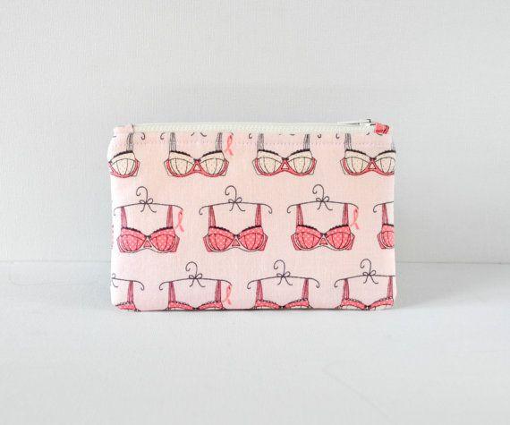 Pink bra gadget padded camera iphone mini cosmetics make up pouch white underwear print fabric.