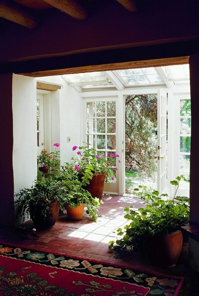 Sunroom w/brick floor & lots of plants= dream home  :)    from Moon to Moon blogspot