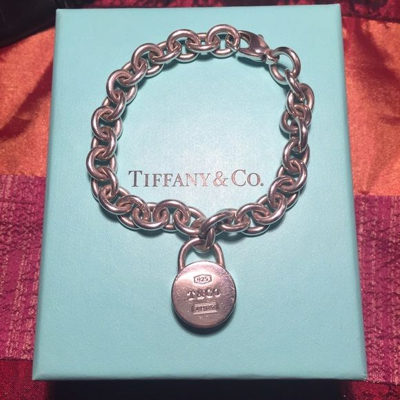 "Tiffany's Charm Bracelet *** (Bracelet ONLY) *** *** Bracelet only *** Super cute and fun charm bracelet. Bracelet is 7"" and currently retails for about $675. Bracelet is in great condition though and polished with Tiffany's silver polishing cloth.  comes with original Tiffany's jewelry pouch and class little blue box  Tiffany & Co. Jewelry Bracelets"