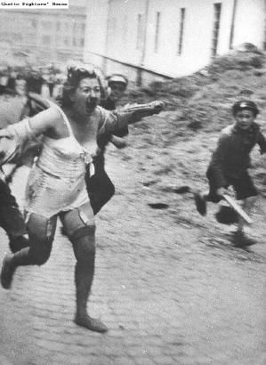 A Jewish woman running screaming through a Lvov street during the pogroms of early July 1941.Ukrainian youths, one holding a stick, are chasing her.On June 30, 1941, Lvov was conquered by the Germans. Pogroms against the Jews began that day, carried out by Ukranian civilians and the German Einsatzgruppe C. The Ukrainians were incited by rumors that the Jews had participated in the murders of Ukrainian political prisoners in the Soviet regime's. by penelope