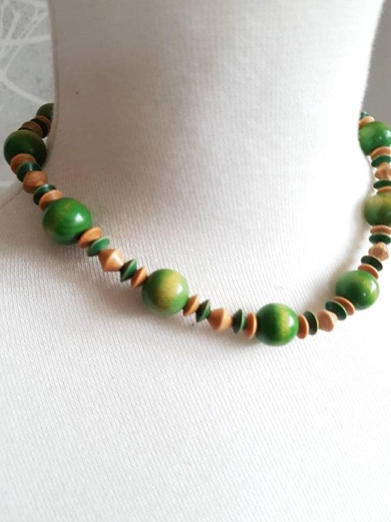 Check out this item in my Etsy shop https://www.etsy.com/se-en/listing/593807190/vintageretro-light-green-wood-necklace
