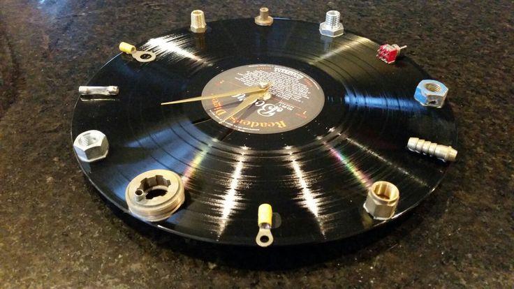 Vinyl record clock for a mechanic