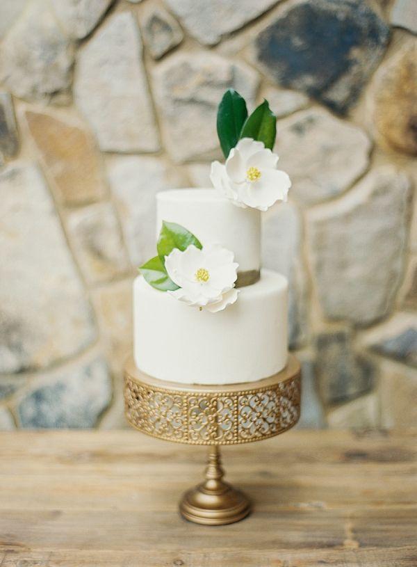 Magnolia Wedding Cake on Gilded Wedding Stand | Classic Wedding Inspiration By Rachel May Photography
