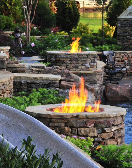 Fire features turn the backyard into a stunning showpiece at night