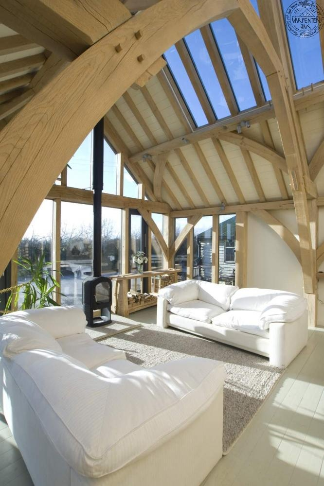 Barn room with close-up of oak sling brace frame, by Roderick James Architects