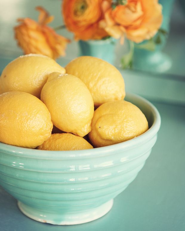 Bowl of Lemons #orange, #yellow #aqua simple, and practical decoration for kitchen table...love this color scheme
