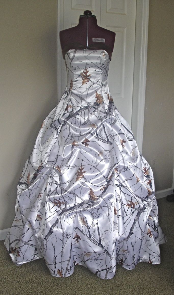 I'm not a fan of Camo, but there is something beautiful about this dress.....