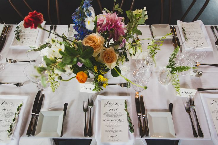 Because the space was so raw and industrial, we wanted to create a balance when selecting the floral arrangements and tablescapes. We kept the decorative elements clean and minimal to play against the natural brick in the venue.