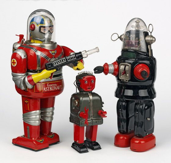 Far left: Robot, c.1950 The first robot is thought to have been produced in the 1940s. By the 1950s a variety robots were being made, most with human qualities and bright colours. Centre: Robot, c.1960 Tin robots were made in Japan for the American toy market. They are all made from lithographed tin plate. These toys are considered to be from the 'golden age' of space toys. Far right: Robby the Robot, c.1956 Robby the Robot is an iconic figure in the genre of science fiction. Like...