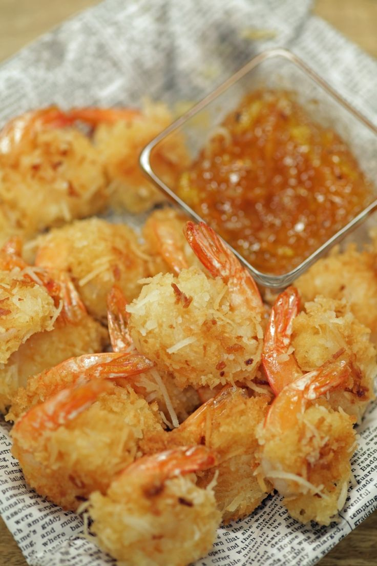 Here's a healthy appetizer that's fit for any upcoming family get-together: coconut shrimp. It's baked, not deep-friend, so it's way healthier than usual and tastes like a tropical island getaway!
