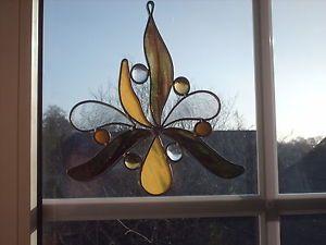 TIFF-Fensterbild-Sonnenfaenger-Glas-in-Blei-braungruen-gelb-Handarbeit