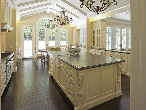 Love the country French styling and the color contrast of the cabinetry and flooring. #cbkitchenislandliving #coachbarn