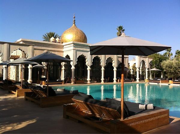 Sat around the opulent poolside,Palais Namaskar
