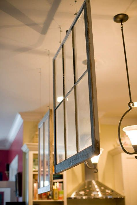 Using hanging glass window panes to designate rooms in a home = awesome