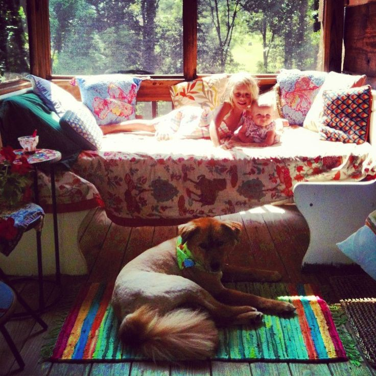 Daybed on screened in porch.