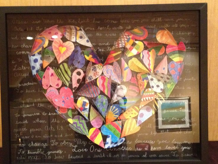 Art project created by a fourth grade classroom  Plain paper hearts were given to the children to decorate  Each was then folded  and the hearts assembled to create one large heart as shown  The hearts were set in a shadow box on which the backside shows a bible verse written in the children  39 s handwriting