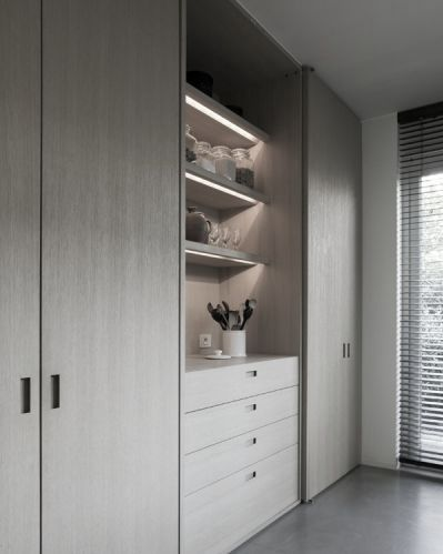 wall of storage, large panels make a clean look with great functionality
