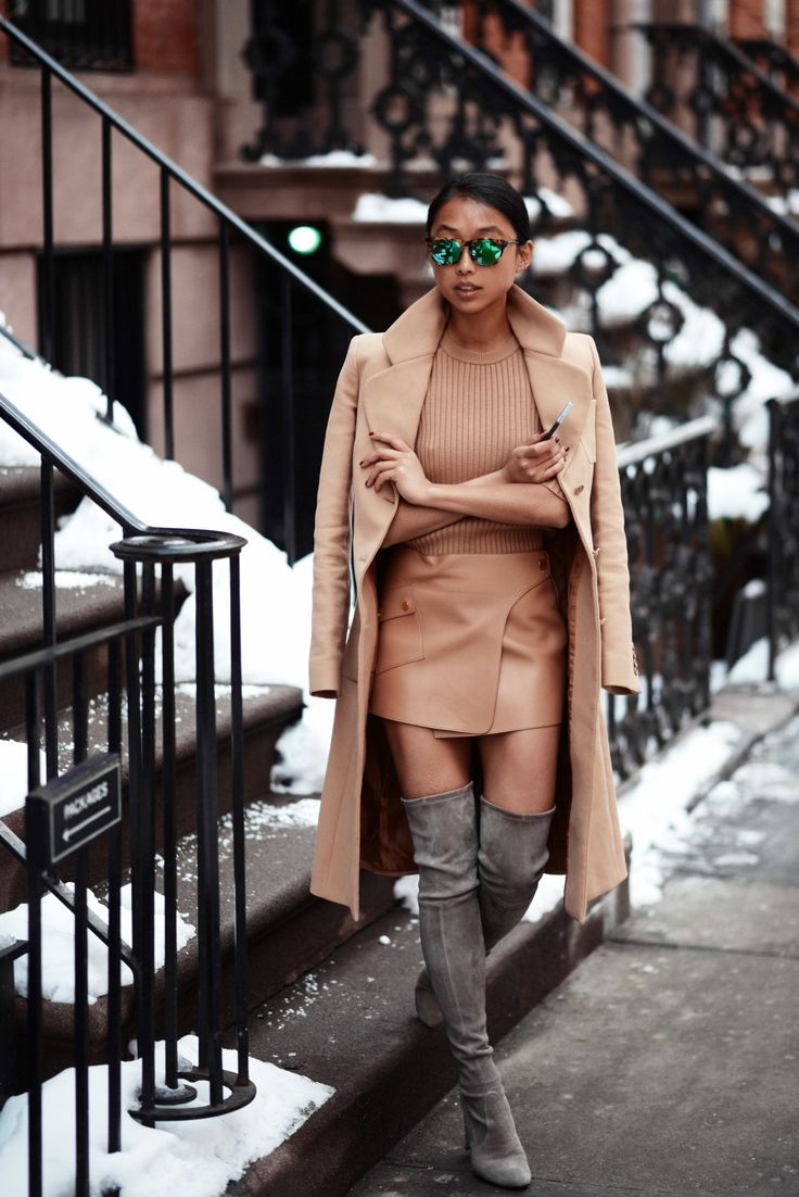 Margaret Zhang Is Wearing Mirrored Sunglasses From Stella McCartney, Coat, Top And Skirt From Michael Kors, Thigh Highland Boots From Stuart...