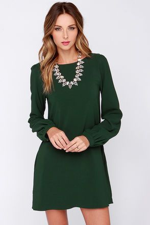 You'll be primed and ready in the Perfect Situation Dark Green Long Sleeve Shift Dress when everything starts falling into place! This woven poly dress has a casual shift shape, accented by a rounded neckline and long sleeves with lightly puffed shoulders. Sleeves end with shining gold button tabs on the fitted wrist cuffs. Hidden side seam pockets. Dress is lined. 95% Polyester, 5% Spandex. Hand Wash Cold. Made With Love in the U.S.A.