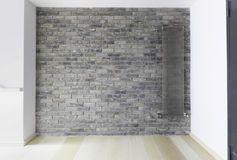 Parede de tijolo com o radiador moderno do calor de vapor Foto de Stock