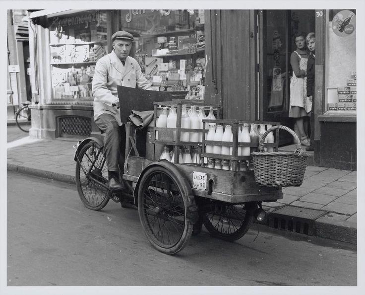 1953. Milk delivery man with cargo bike in a street in Amsterdam. Photo Algemeen Hollands Persbureau / Ben van Meerendonk. #amsterdam #1953