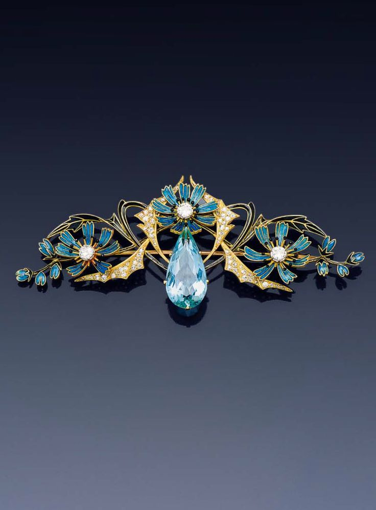 HENRI DUBRET - An Art Nouveau gold, enamel, diamond and aquamarine brooch. Designed as stylised flowers and bat wings in 18k gold set with a pear-shaped aquamarine at the centre, enhanced with three blue enamelled flowers set with old-cut diamonds, and four bat wings set with diamonds and black enamelled foliate motif. Signed H. Dubret, and numbered.