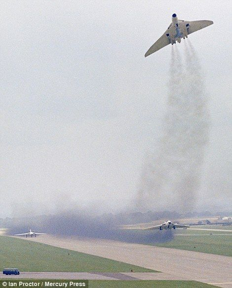 Three Vulcan B2s of 617 Squadron, carrying Blue Steel training rounds, demonstrate a dispe...