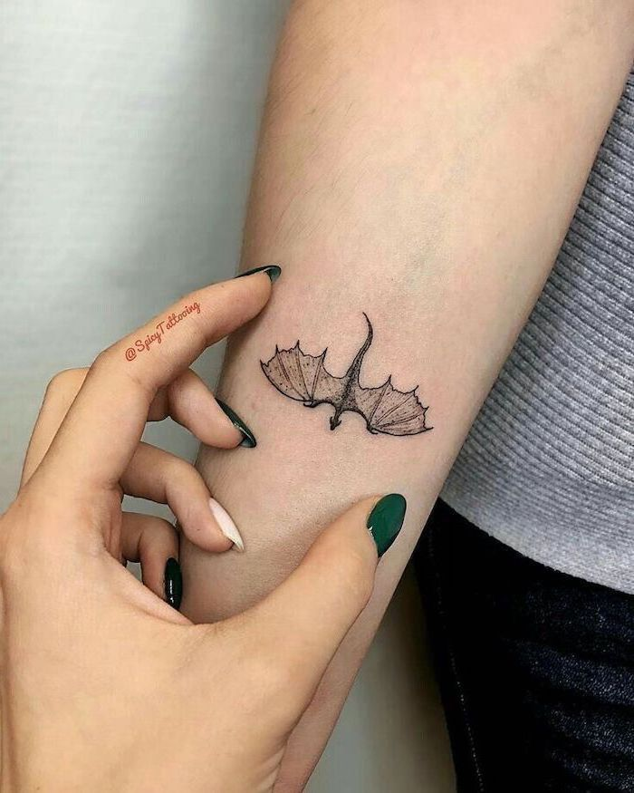 Small Dragon Tattoo On The Forearm Dragon Tattoo Meaning Woman With Green Nail Polish In 2020 Tiny Tattoos For Girls Tattoos For Women Small Tattoos