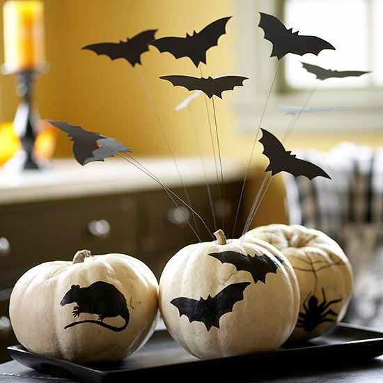 Creepy Nocturnal Creatures. Add height and dimension with small bats attached to wire and stuck into a pumpkin centerpiece.