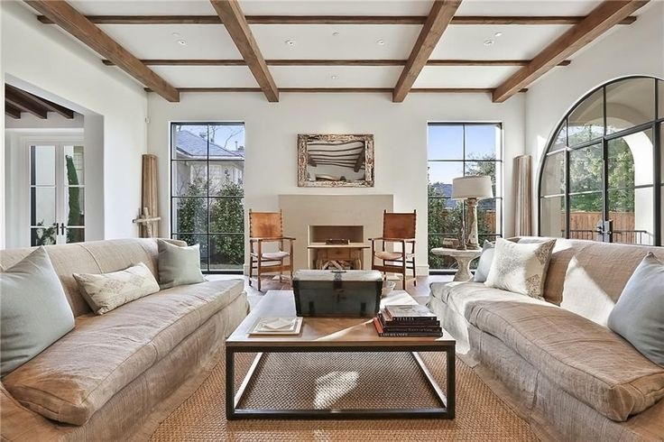 Give your living room a cozy natural feel by incorporating a variety of wooden pieces in different hues.