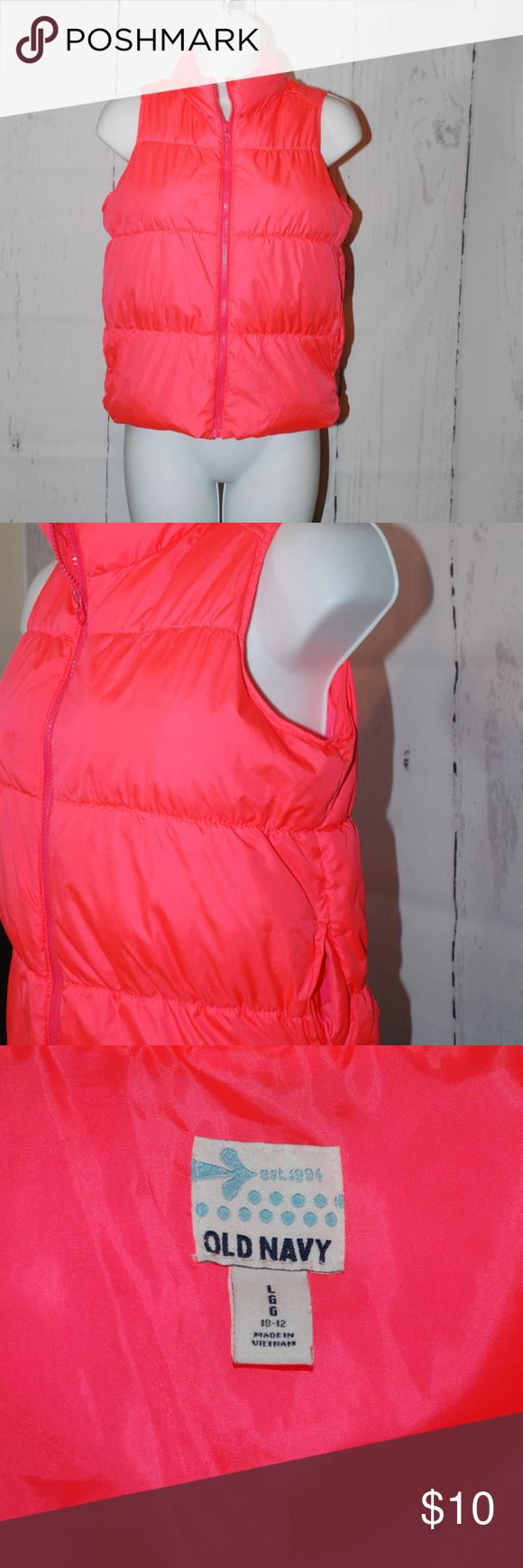 Old Navy girls puffer vest size 10-12 bright neon Old Navy girls puffer vest size 10-12 bright neon Adorable puffer vest bright bold color smoke free home excellent clean conditon zip up front Old Navy Jackets & Coats Puffers