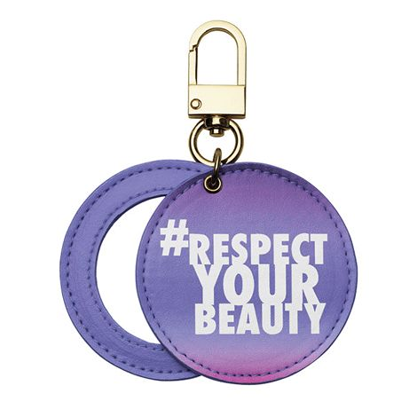 Features #Respect Your Beauty on the outside and a slide-out mirror. Faux leather with goldtone hardware. 7 cm diam.   Avon will donate 10% of the sale price of this product to the Avon Foundation for Women Canada to support Speak Out Against Domestic Violence programs across the country.