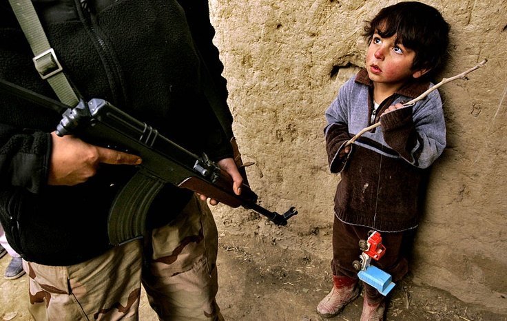 Kabul, Afghanistan — A young Afghan boy holds on to his toy truck during a drug raid by anti-narcotics police. Two men were arrested for illegal weapon possession.  PHOTOGRAPH BY: CAROLYN COLE: Hold On, Young Afghans, Toys Trucks, Boys Hold, Afghans Boys, Carolyn Cole, Drugs Raid, Little Boys, Photography Inspiration