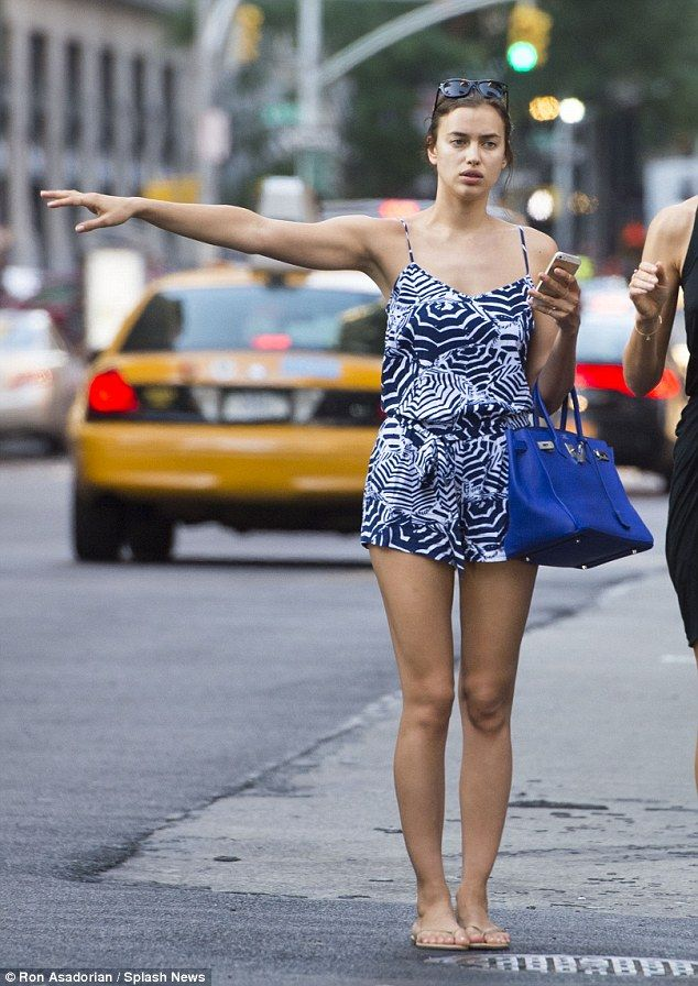 Irina Shayk flagged down a taxi in New York while wearing a flirty blue and white playsuit http://dailym.ai/Un29r6