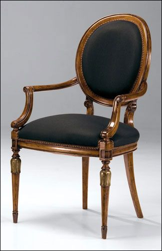 Louis XVI style carved beechwood armchair with hand-rubbed walnut finish, antiqued silverleaf accents and black muslin upholstery, Made in I...